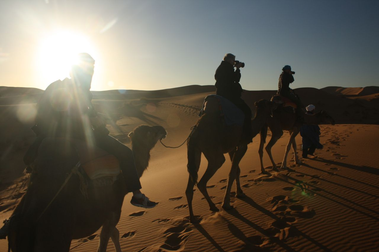 AR OSE riding camels at Erg Chebbi in the Sahara